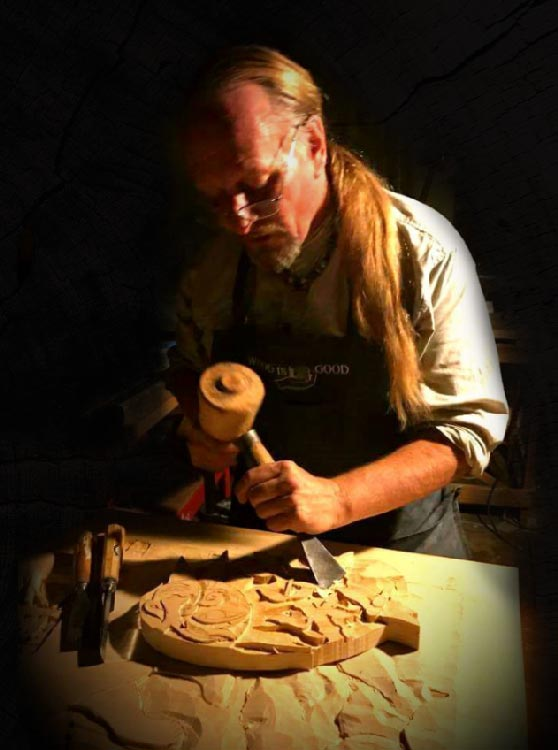 Ray Kinman, carving in a dark room.